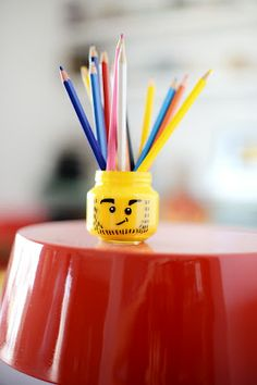 Lego head pencil holder made from a  baby food jar!
