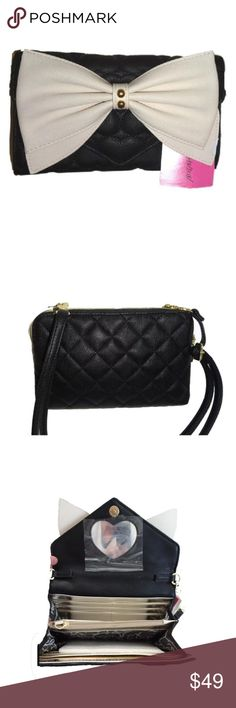 BETSEY JOHNSON BLACK /BONE BOW /CROSS BODY WALLET GENUINE BETSEY JOHNSON CROSS BODY/WALLET  Quilted heart faux leather cross body/wallet Wallet is 5 x 8 has 10 credit card slots, 2 slots for bills,  center dividing zipper compartment and a mirror Can be worn as a cross body with strap attached or as a clutch or wallet  BAG IS FROM A SMOKE AND PET FREE ENVIRONMENT SHIPMENT IS USUALLY WITHIN 24 HOURS Betsey Johnson Bags Crossbody Bags