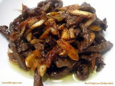 Beef Salpicao is a Filipino dish of Spanish or Portuguese influence.  It's  beef tenderloin cut into small pieces or strips and marinated in olive oil and sauteed with garlic..lots of garlic!