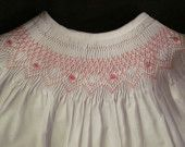 hand smocked baby gowns with a tie in the back