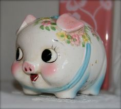 A cute-as-a-button vintage piggy bank. #kitsch #coin_bank #vintage