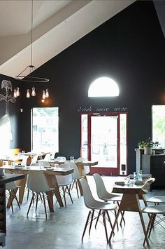 Love the mix of black and white paint, the rustic wood elements, and the red door... fun chalkboard walls