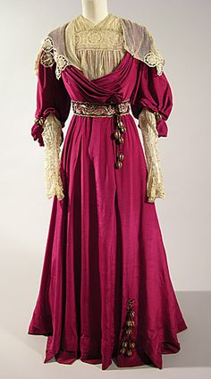 A beautiful dark raspberry and soft cream hued dress, circa 1906, from the Brighton & Hove Museums.