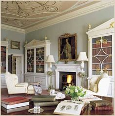 Blue sitting room Built in library cabinets and decorative plaster ceiling design