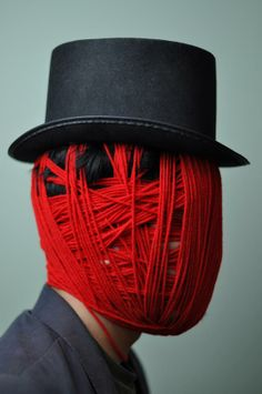 Chris McGuigan art threads line red face wrapping chic hat