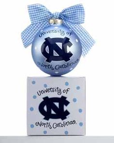 The University of North Carolina logo is displayed on the center of this Carolina blue glass ornament.  On the back is Go Heels! Tar Heel fans everywhere will love this ornament!  It is topped off with a blue and white gingham ribbon.  Buy it now for only $21.95 at www.ornamentshop.com