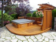 Outdoor deck and hot tub setup.