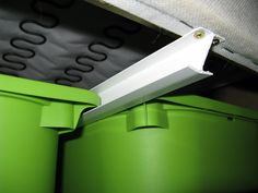 Hidden storage for Ektorp   4 Trofast containers   5x 63 cm pieces of H-profile, width of H-profile   screws (width 3mm x length 20mm) or similar   1-Turn Sofa on its back.   2-Cut the end of the profiles under a 45 degree angle on each side.   3-Drill 2 holes on each side of the profiles.  4-Fit the 5 profiles starting with the one in the middle. Then use 1 of the Trofast containers to determine the position of the next profile.   5-Slide in the Trofast containers.