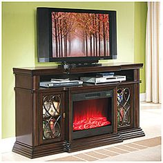 """$499.99 Movie nights have never been more comfortable! Refine your living room with this warm media fireplace, finished with rich walnut and cherry veneers and elegant ash burl details. Electronics and accessories not included.  Features:  2 Glass doors with slow close hinges and elegant inlays 4800 BTU 29"""" Fire insert with 1 year warranty Remote control Assembly required"""
