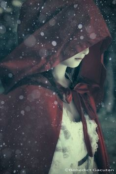 She sighed softly and closed her eyes, tilting   her head back at the sky letting the snow fall and melt on her face, then only to see that the soup was getting cold so she started off into the forest only thinking of it as a shortcut not knowing the consequences of what could happen.~Emily  J