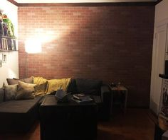 A couple hangs brick paneling in their living room, but then they do this!