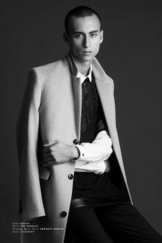 Hunter wears coat Jaeger, shirt The Kooples, and vintage mesh shirt Emporio Armani.