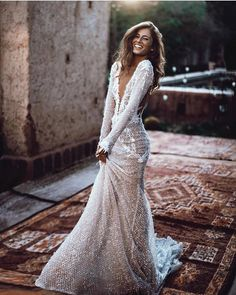 The sparkly beaded fishnet and fringing of our mermaid wedding gown shimmers beautifully in the Moroccan sunshine. Photo: by Tali Photography Mermaid Sexy Deep V-back Wedding Dress.The professional tailors from wedding dress Dream Wedding Dresses, Designer Wedding Dresses, Bridal Dresses, Wedding Gowns, Wedding Bride, Long Sleave Wedding Dress, Sparkly Wedding Dresses, Long Sleeved Wedding Dresses, Fitted Wedding Dresses