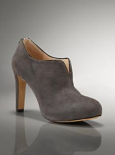 Beautiful grey ankle boots. These are absolutely gorgeous. I like the triangle cut into the top. Cute.