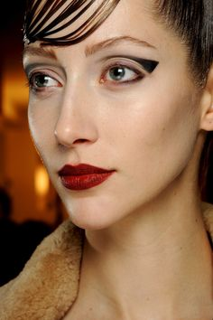 Spring Summer 2013 Couture Beauty Round-Up - Skin was dewy, whilst lips were painted a matte red.