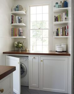 Custom cabinets with countertop to hide washer and dryer