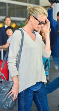 Charlize Theron looks casual but polished in her latest airport ensemble