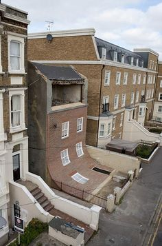 House in Margate with a facade that's slipped down by Alex Chinneck