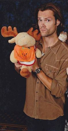 Jared with a moose and a squirrel or hamster on his shoulder.