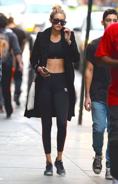 Hadid wears a Sweaty Betty bra and Adidas leggings paired with a long winter coat while out and about in New York.