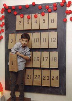 create an advent calendar on a chalkboard. Looks lovely