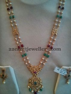 South sea pearls, ruby drops, emerald drops combination two layers long chain with two step pachi work designer pendant. Studded with u...