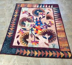 Wild flowers was my first American beauty quilt. Beautiful batik fabric makes it so pretty!