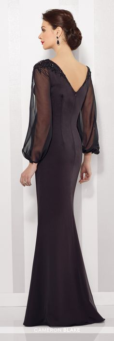 Cameron Blake - 216680 - Stretch crepe and chiffon sheath features billowing illusion chiffon long sleeves with slit and cuffs, hand-beaded shoulders, bateau neckline, curved V-back.Sizes: 4 - 20Colors: Black, Aubergine