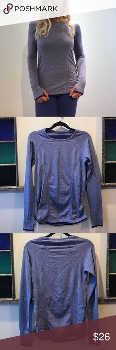 Athleta long sleeve Athleta long sleeve running tee. Super cute, rusching on sides for a flattering fit, and thumb holes for those chilly days! Athleta Tops Tees - Long Sleeve