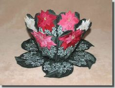 Lace Bowl & Doily Poinsettias  A sophisticated bowl of poinsettias to welcome the Holiday season. The three bowl side designs are basically the same design but the flowers have different numbers of color changes. The red uses four shades, the pink three shades and the white flower has two shades. In this way you can decide how dramatic you want your flowers!