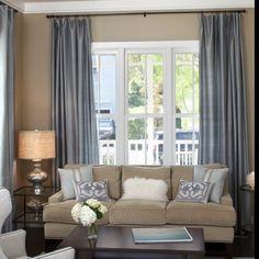 Gray and beige colour scheme for the living room renovation.