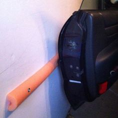Cut a pool noodle in half, use 3 screws with washers to hold to the wall or liquid nails, measure up the wall to correct height for your car/truck door. secure the noodle... No more worries for bumping your doors as you get in and out of your car in the garage.