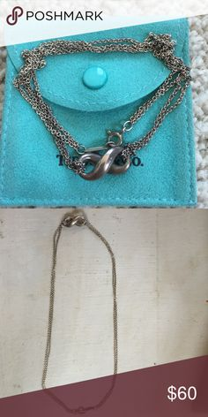 Tiffany & Co Infiniti choker necklace Sterling silver infinity. Double chain on each side. It's a short necklace, rests right at your collar bone. Needs to be polished. Tiffany & Co. Jewelry Necklaces