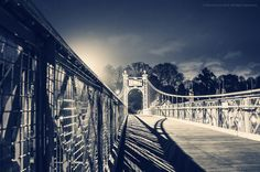 Suspension Bridge at night over the River Dee in the centre of Chester in England