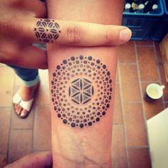 Black and grey dotwork mandala tattoo design