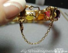 HUZZAH! If you don't know how to solder and don't have the beads with loops or a bail that you can use, here is a great tutorial for adding a safety #chain onto your #bangles and #bracelets!  Here is another Great tutorial by one of our friends,   Bobby Maw of MyWiredImagination  http://www.handmade-jewelry-club.com/2012/06/featured-free-tutorial-adding-safety.html#