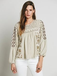 I love the various takes on the peasant blouse we are seeing lately!