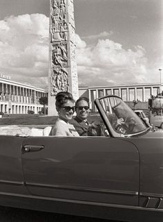 Hepburn and first husband Mel Ferrer take a drive in an Alfa Romeo around Rome's E.U.R. district in 1961.