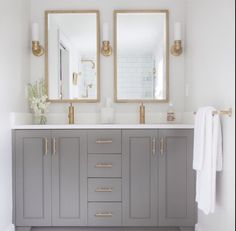 Stunning Bathroom Boasts A Gray Dual Vanity Adorned With Brass Knobs - Brass colored bathroom faucets