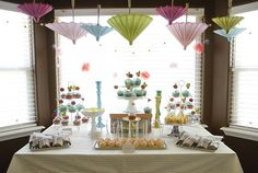 how i love the lil umbrellas... how this could easily translate to a geisha party, gothic romance, baby shower...