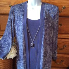 "R&M Richards Light Purple Sparkled Top This is an all in one with attached jacket.  Excellent condition. Approximately 27"" in length and when flat it measures 23"" across armpit to armpit. I has a few shades of purple in it, some white and sparkles.  The necklace is also attached but can be removed.  95% acetate and 5% spandex.  Has some stretch. Doesn't really wrinkle.  R&M Richards Tops Tunics"