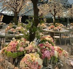 Sources have told the Mail that the theme of the night was 'Enchanted Forest'. The dinner tables, covered with spring green table cloths, groan with the weight of pretty pink and white roses, interspersed with deep green foliage