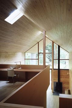 """""""Omizubata N House has a curious quality of looking deceptively small from certain exterior angles, but when viewed from the inside, the overt spaciousness of the structure becomes clear. The prominent gabled roof allows a mezzanine desk area to be fitted, well above the main downstairs living area, while still having the equivalent of a double height ceiling."""""""