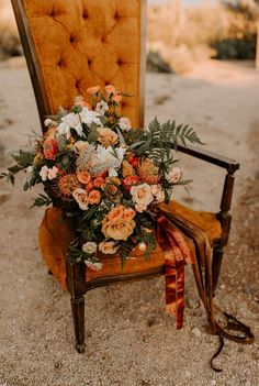 @megbrookephotography desert engagement. I love this picture of my bouquet and this old orange velvet chair.