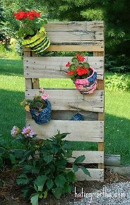 pallet flower pot hanger, flowers, gardening, pallet, A pallet is cut in half and used to hang potted flowers The flowers hang with wire hangers bent into shape