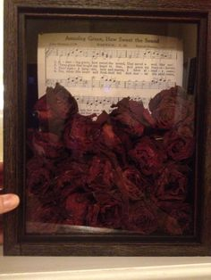 Shadow box. Made with roses from my grandmother's funeral and used amazing grace music (sang at her funeral) for the background