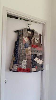 Hand made and hand stitched Vest. Materials predominantly cotton, size will fit 12-14-16. Length 28cm, across shoulders 17cm and under arm 23cm across back.
