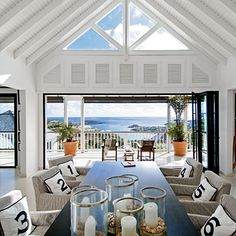 open plan living with a cut out on left side of picture to create defines spaces. like the windows and big doors