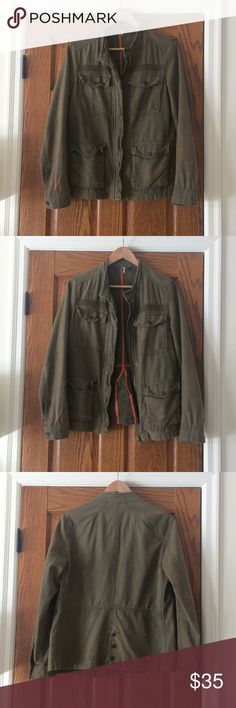 Free People jacket Army green coat with distressed detailing. Buttons down the back and a cool thick zipper. Looks great with a dress or jeans and a top! Free People Jackets & Coats