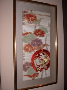 My mother's obi, framed and proudly displayed in my home. She started embroidering this in the early 1900's to wear on Coming of Age Day.